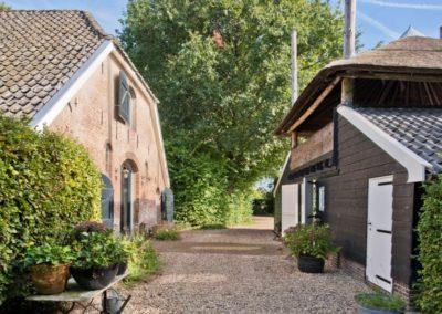 Monumentale woonboerderij met serre en hooiberg